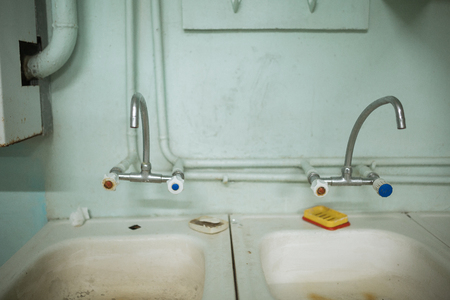 filthy: awful, unsanitary, filthy sink. Stock Photo