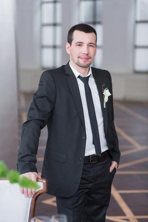 Handsome Elegant Groom In Black Wedding Tuxedo With White Shirt ...