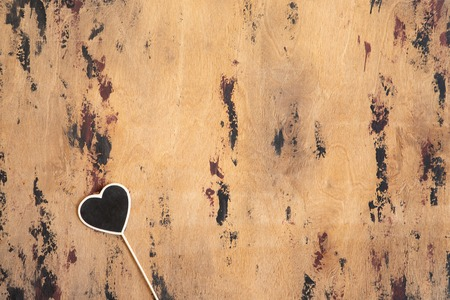 Vintage heart shaped chalkboards or signbaords with copy space in wooden frame on wooden background, flatlay