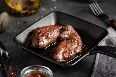 Grilled meat Steak Machete with salt and pepper on slate board black background 스톡 콘텐츠