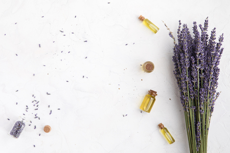 Organic cosmetic with lavender flowers and oil on white background with copy space, top view and flat lay 스톡 콘텐츠