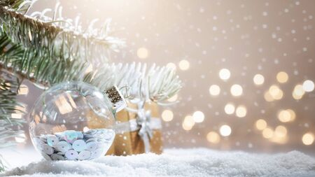 Christmas decorations banner. Snowy Fir-tree branch with Christmas lights bokeh. Panoramic background. Xmas composition. New Year 2020 holidays