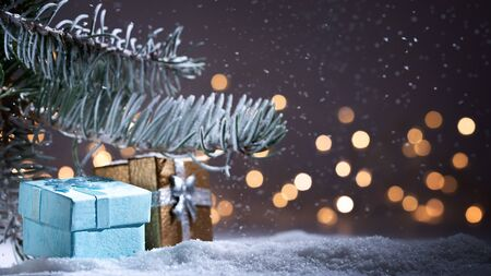 Xmas time and gifts with night time and lights. Christmas background with snowfall, Christmas evergreen tree