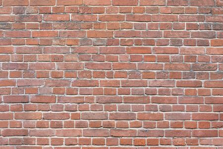 Old red brick wall background, wide panorama of masonry 免版税图像
