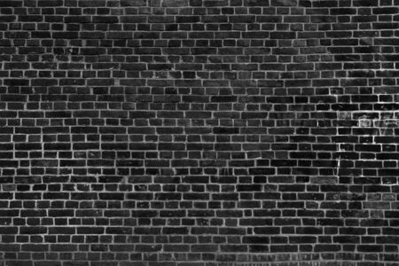 Old vintage black brick wall texture for background, wide panoramic backdrop 写真素材