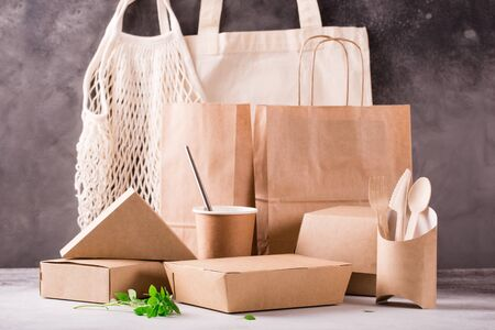 Food eco packaging made from recycled kraft paper. Flat lay concept of environmental protection, nature conservation, recycle, zerp waste. Eco-friendly dishes