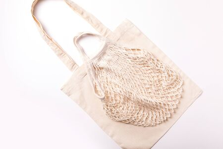 Canvas cotton shopping eco friendly bag over white background. Zero waste, plastic free concept. Top view, flat lay 스톡 콘텐츠 - 129513591