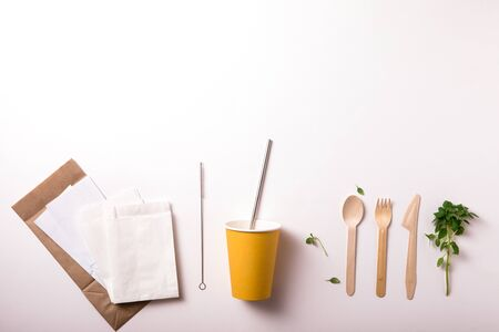Top view of set of Eco-friendly bamboo cutlery, eco bag, water bottle. Sustainable lifestyle. Flat lay. Plastic free concept. 写真素材