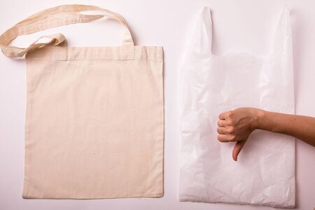 Canvas cotton shopping eco friendly bag over white background. Zero waste, plastic free concept. Top view, flat lay