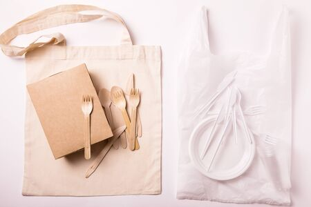Set of Eco friendly reusable bamboo cutlery and bag and plastic waste on white background. Top view of sustainable lifestyle. conscious choice, plastic free concept. Flat lay 写真素材