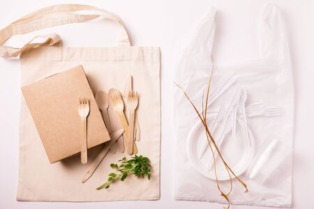 Set of Eco friendly reusable bamboo cutlery and bag and plastic waste on white background. Top view of sustainable lifestyle. conscious choice, plastic free concept. Flat lay 스톡 콘텐츠 - 129566749