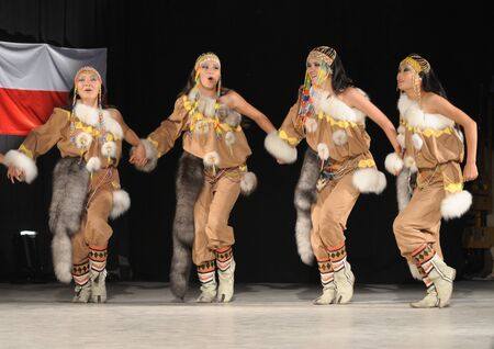 folkloristic: Warsaw, Poland - August 19, 2010 - Folklore Ensemble MICHAAR from Sakha (Yakutia) Republic of Russia - performs folk dances during the International Folklore Festival WARSFOLK. Editorial