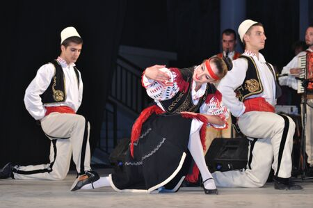 Warsaw, Poland - August 19, 2010 - The National Folklore Ensemble from Albania - performs folk dances during the International Folklore Festival WARSFOLK. Stock Photo - 8844088
