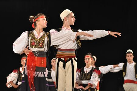 folkloristic: Warsaw, Poland - August 19, 2010 - The National Folklore Ensemble from Albania - performs folk dances during the International Folklore Festival WARSFOLK. Editorial