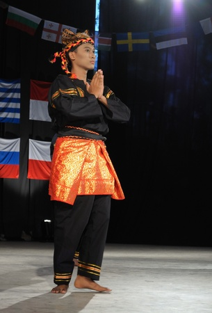 folkloristic: Warsaw, Poland - August 19, 2010 - Dancer of team TETA from Indonesia - performs folk dance during the International Folklore Festival WARSFOLK Editorial