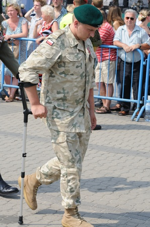 wounded: Warsaw, Poland - August 15, 2010 - Veteran of Afghanistan, arrives at the celebrations of Polish Armed Forces Day.