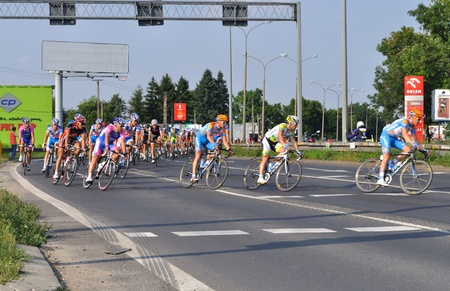 peloton: Warsaw, Poland - August 1, 2010 - Cyclists during Stage 1 of the Tour de Pologne - from Sochaczew to Warsaw. Editorial
