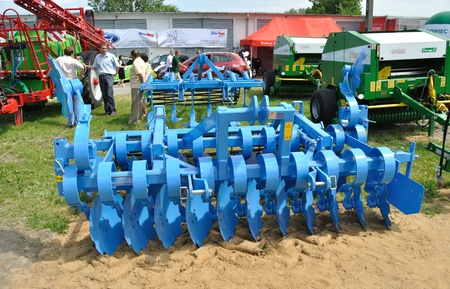harrow: Plonsk, Poland - June 12, 2010 - Disc harrow showcase, during the 11th Masovian Agriculture Days. Editorial