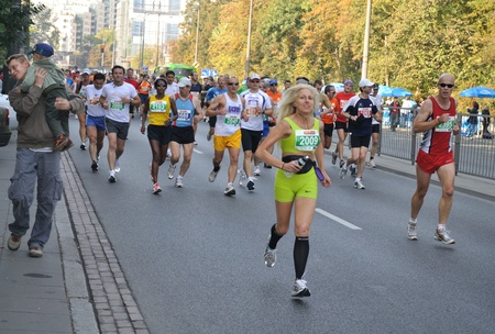 Warsaw, Poland - September 27, 2009 - Runners participating in the 31st Warsaw Marathon. More than 3000 participants was finished this Marathon. Stock Photo - 9444652