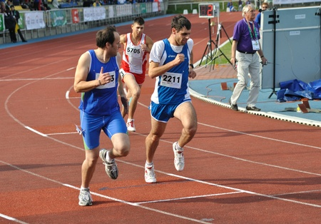 summer olympics: Warsaw, Poland - September 20, 2010 - Runners competing at 800 m during the Special Olympics European Summer Games - ELIOS 2010 - international sporting competition for athletes with intellectual disabilities. Editorial