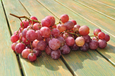table grapes on the table boards photo