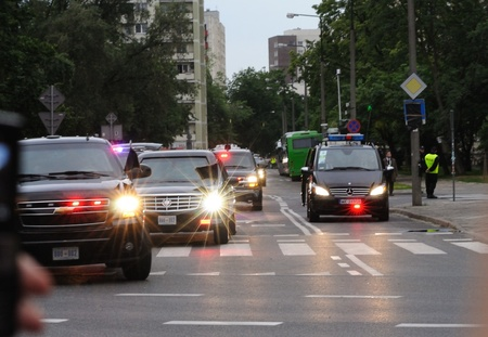 Warsaw, Poland - May 27, 2011 - Presidential motorcade transporting U.S. President Barack Obama in Warsaw streets.