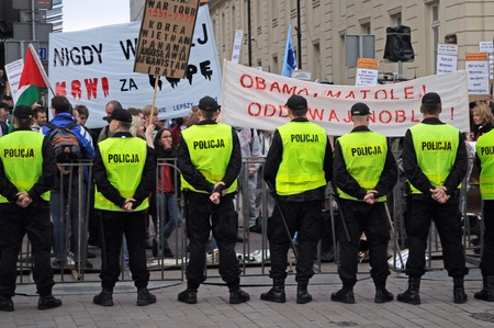 Warsaw, Poland - May 27, 2011 - Police watch over protesters in front of the presidential palace, while U.S. President Barack Obama arrival to Poland.