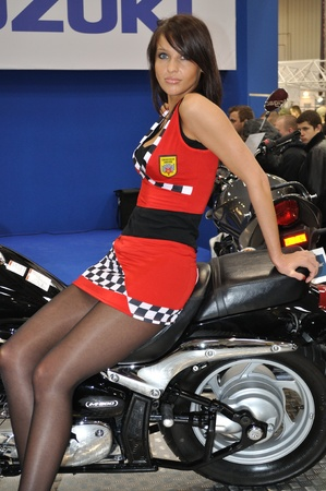 Warsaw, Poland - February 21, 2010 - Attractive girl at the exhibition of motorcycles.