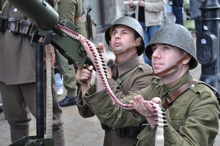 reenact: Warsaw, Poland - August 29, 2010 - Participants of defense of Warsaw against the German invasion (at the beginning of World War II), reenact the Polish soldiers. Editorial