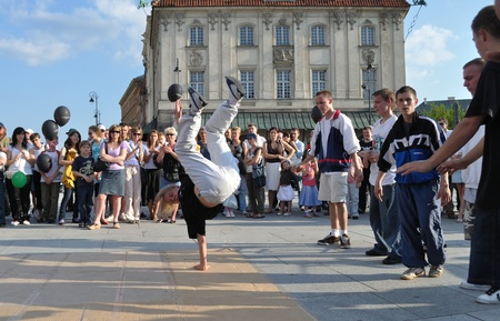 Warsaw, Poland - June 28, 2009 - Street dancer performs breakdance moves in the Warsaw Old Town.