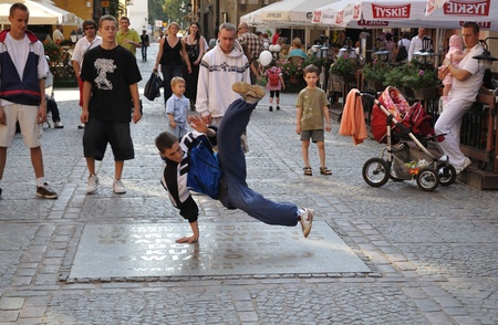 performers: Warsaw, Poland - June 28, 2009 - Street dancer performs breakdance moves in the Warsaw Old Town. Editorial