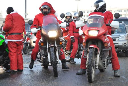 Warsaw, Poland - December 5, 2010 - MOTOMIKOLAJKI 2010 - annual gathering of Santas on bikes, as part of helping children in orphanages.