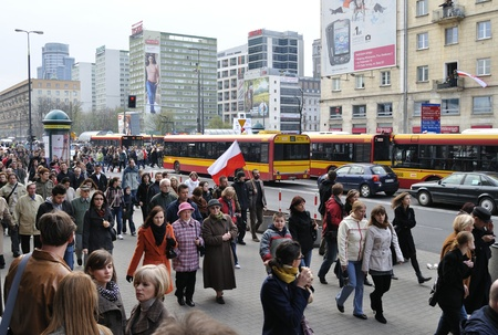 lugubrious: Warsaw, Poland - April 11, 2010 - People going to the Presidential Palace, to pay tribute to the Polish President Lech Kaczynski, and the other victims of the plane crash.