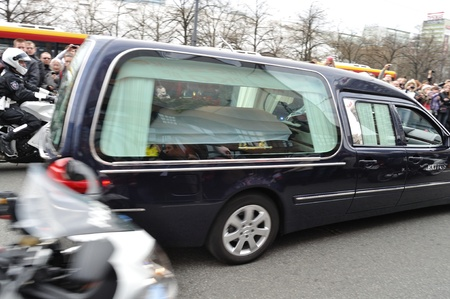 mournful: Warsaw, Poland - April 11, 2010 - Hearse carrying the coffin of Polish president, who was killed in a plane crash in Russia.