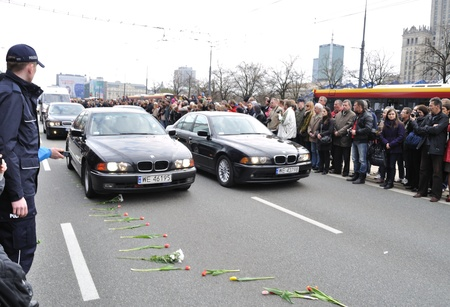Warsaw, Poland - April 11, 2010 - Cars following the hearse with the coffin Polish president, that was killed in a plane crash.