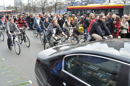 Warsaw, Poland - April 11, 2010 - Cyclists following the hearse with the coffin Polish president, that was killed in a plane crash.