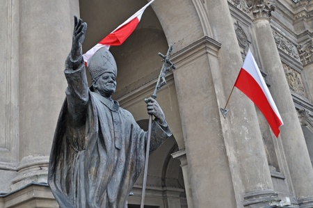 beatification: Warsaw, Poland - November 11, 2010 - Monument of pope John Paul II outside The Church of All Saints. It was unveiled on October 16, 1994, and was created by Italian sculptor Giorgio Galletti da Muggio.