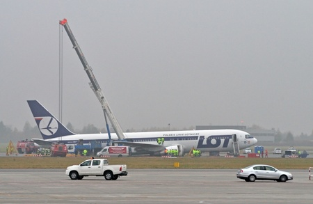 unblock: Warsaw, Poland - November 2, 2011 - Frederic Chopin airport - Preparing to move a Boeing 767 to unblock airport runways. The plane made a safe emergency landing on its belly, after a catastrophic failure of all its landing gear on November 1, 2011. Editorial