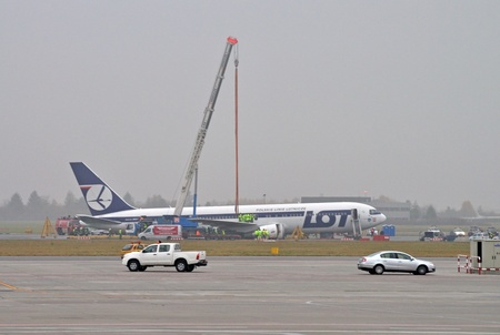 Warsaw, Poland - November 2, 2011 - Frederic Chopin airport - Preparing to move a Boeing 767 to unblock airport runways. The plane made a safe emergency landing on its belly, after a catastrophic failure of all its landing gear on November 1, 2011.