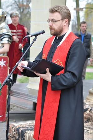 cassock: Gora Kalwaria, Poland - April 17, 2011 - Speech by Fr Wojciech Skora, during the street performances Mystery of the Passion. Editorial