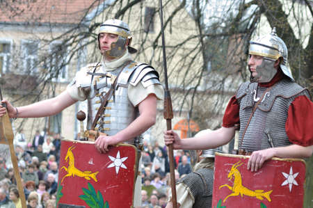 legionaries: Gora Kalwaria, Poland - April 17, 2011 - Reenactment of the Roman legionaries, standing on guard, during the street performances Mystery of the Passion. Editorial