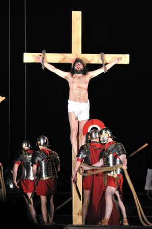 Warsaw, Poland - April 16, 2011 - Mystery of the Passion - Actors reenacting the crucifixion of Jesus Christ by Roman soldiers. Outdoor spectacle, directed by Artur Piotrowski.