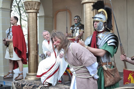 Gora Kalwaria, Poland - April 17, 2011 - Actors reenact the trial of Jesus in praetorium before Pontius Pilate, during the street performances Mystery of the Passion.