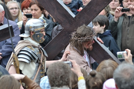 Gora Kalwaria, Poland - April 17, 2011 - Jesus carrying his cross, on the way to his crucifixion, during the street performances Mystery of the Passion. Stock Photo - 12768509