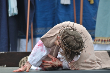 easter triduum: Gora Kalwaria, Poland - April 17, 2011 - Jesus falls on the way to his crucifixion, during the street performances Mystery of the Passion.