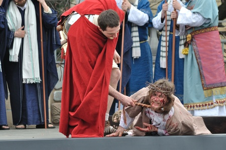 downfall: Gora Kalwaria, Poland - April 17, 2011 - Jesus falls on the way to his crucifixion, during the street performances Mystery of the Passion.