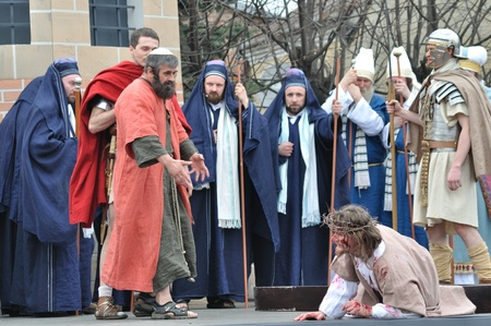 crucis: Gora Kalwaria, Poland - April 17, 2011 - Jesus falls on the way to his crucifixion, during the street performances Mystery of the Passion.