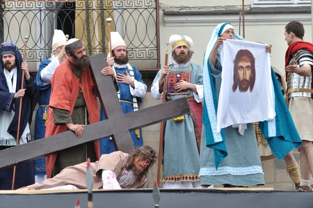 Gora Kalwaria, Poland - April 17, 2011 - Veronica holding a cloth that bears the image of Christs face, during the street performances Mystery of the Passion. Stock Photo - 12819428