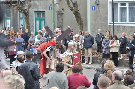 Gora Kalwaria, Poland - April 17, 2011 - Jesus carrying his cross, on the way to his crucifixion, during the street performances Mystery of the Passion. Stock Photo - 12925710