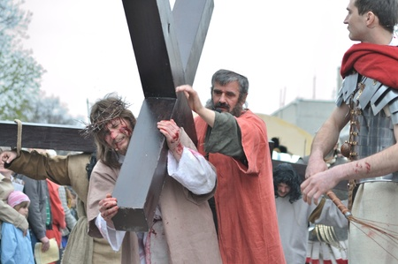 Gora Kalwaria, Poland - April 17, 2011 - Jesus carrying his cross, on the way to his crucifixion, during the street performances Mystery of the Passion.